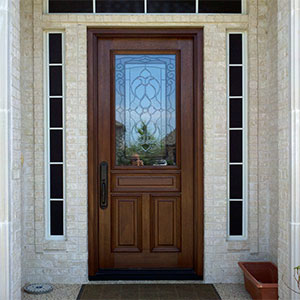 Traditional Mahogany entry door with decorative glass